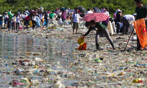 Filipino volunteers pick rubbish during the 29th International Coastal Cleanup at the shore of the 'Long island' in Paranaque city, south of Manila. Photograph: RITCHIE B. TONGO/EPA