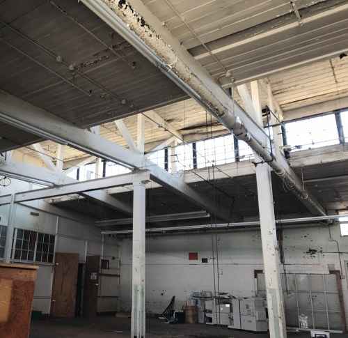 The 1915 portion of Grey Hosiery Mill has bead-board ceilings and clerestory windows. Heavy timber posts support the roof beams.