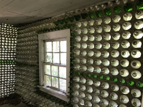 Inside one of the small Bottle Houses built by Charlie Yelton