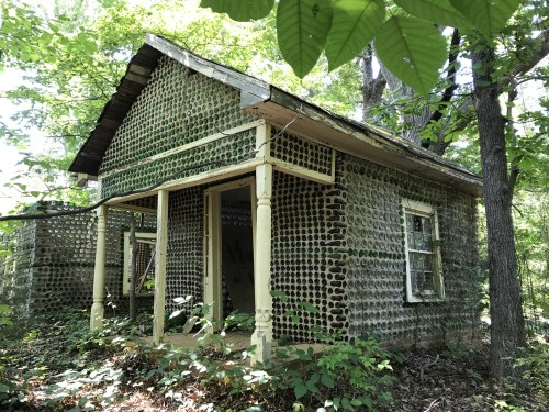 One of the small Bottle Houses built by Charlie Yelton