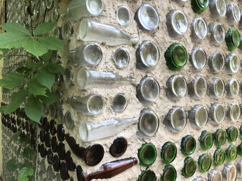 Charlie Yelton built houses using bottles as bricks.