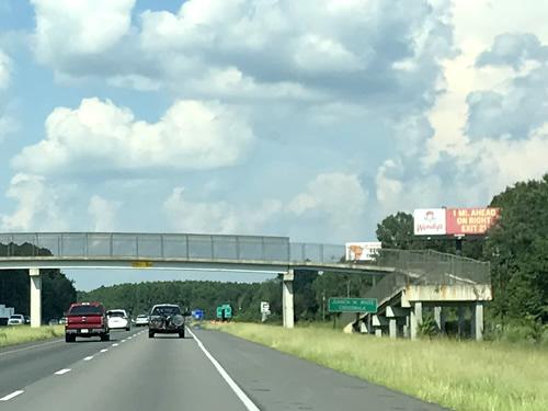 The Juanita M. White Crosswalk Pedestrian Bridge over I-95 from our car, driving north