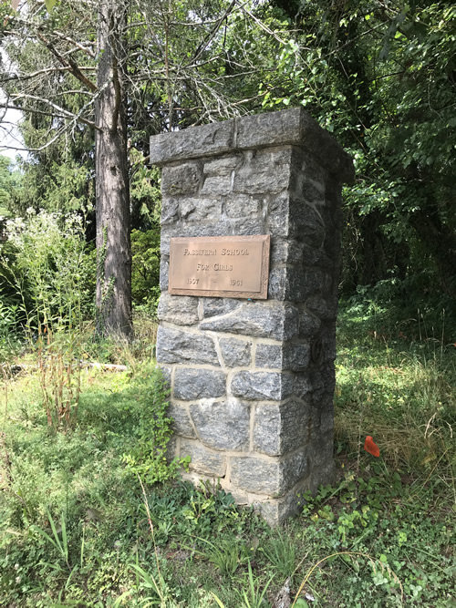 The stone column with a plaque about Fassifern School