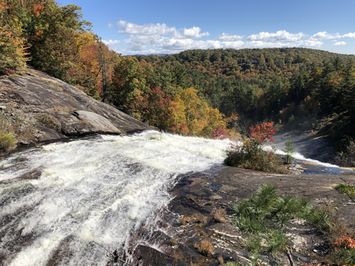 The dam burst scraped off all the soil and trees and scoured the land down to the rocks at Toxaway Falls