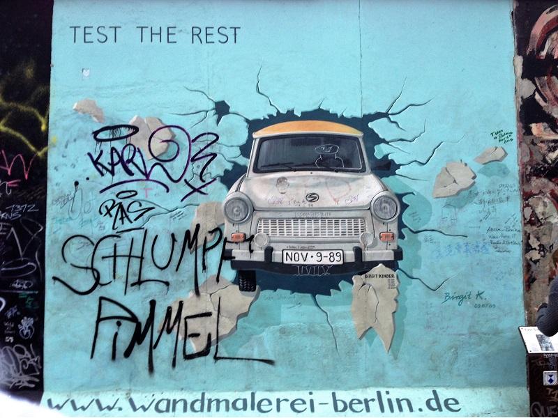 """Test the rest"" breaking through the Berlin wall - street art"