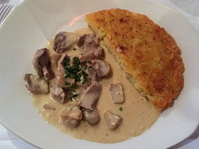 Zuerich gschnaetzeltes mit rosti, veal and mushrooms in white sauce with potato rosti at the Marriott Hotel