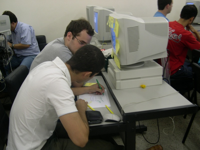 Two young men in front of a computer.