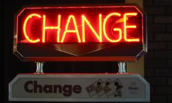 Neon sign: change. Change is the only constant.