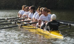 A team rowing the boat.
