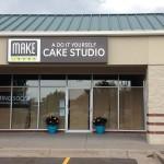 Cake Studio lighted sign cabinet