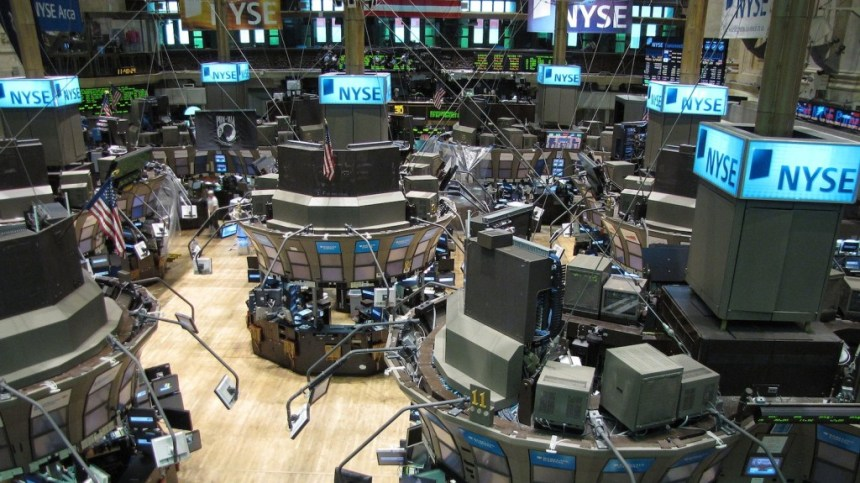 Floor of the New York Stock Exchange, cropped; photo by Kevin Hutchinson; CC BY 2.0