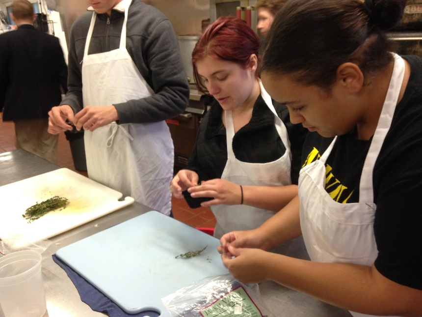 Chelsea Fosella (left) and Jennaya Jones practicing their skills during Railroad Street Youth Project's 2014–2015 Culinary Apprenticeship Program. Jennaya, in her seventh culinary apprenticeship with RSYP, is now an intern at Red Lion and hopes to attend the Culinary Institute of America next year; submitted photo.