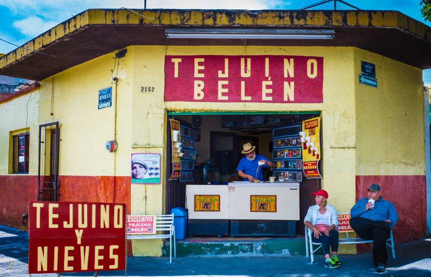 Food writer Betty Fussel traveled to Guadalajara, Mexico to unlock the secrets of tejuino, a drink made by brewers who have learned how to ferment corn with patience and skill. Her connection with master tejuinero Juan Miguel Gonzáles Cárdenas (pictured pouring), took her on an odyssey through history, science and culture that will transport you. Any plane reservations you book are not the fault of the author, the magazine, or this podcast network...(photo, Carla Francescutti).