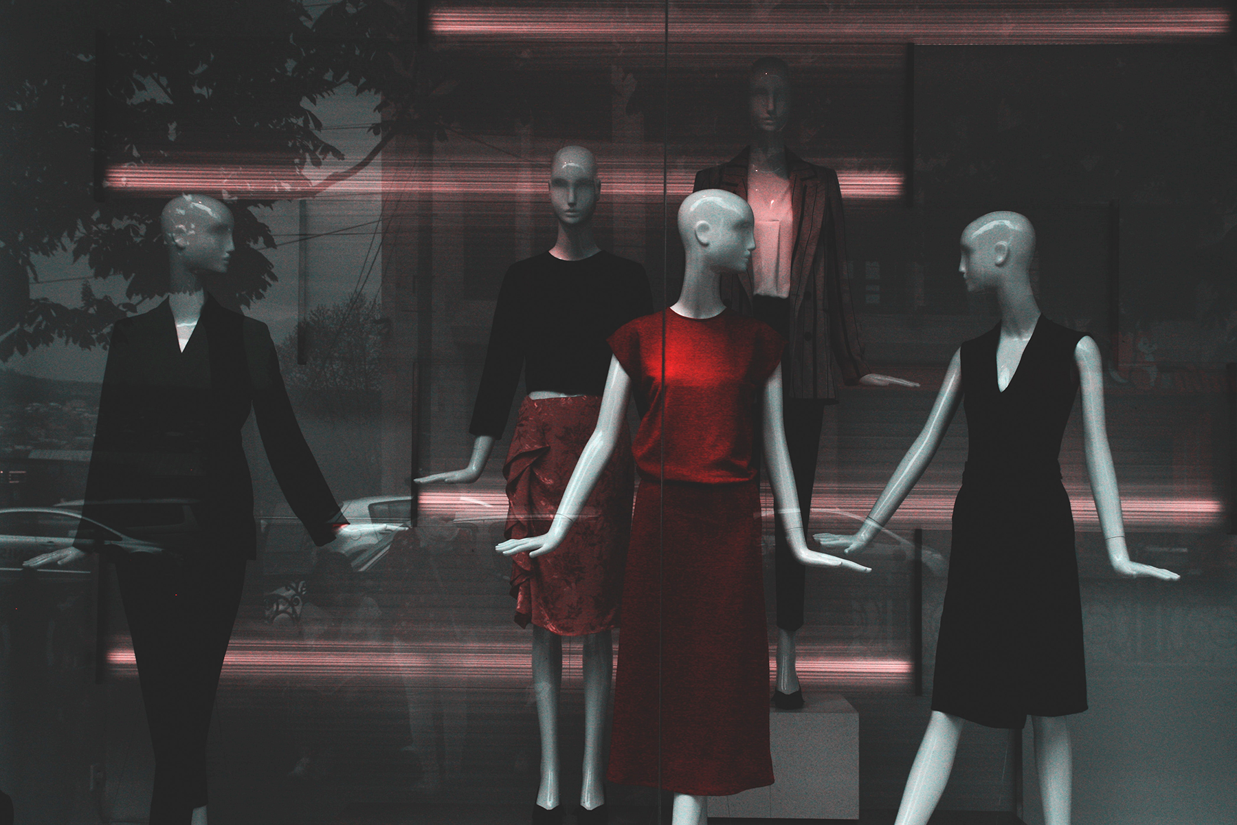 Mannequins doing their best to incite consumer desire; photo by George Shervashidze, from Pexels