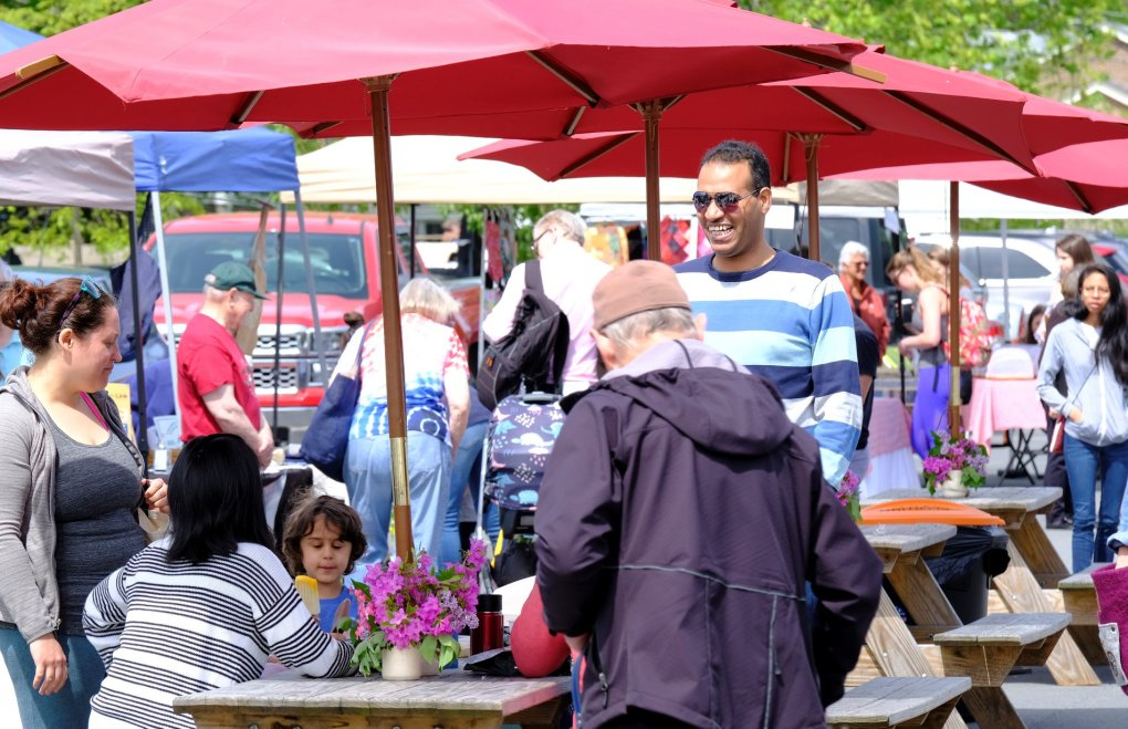 Shoppers at the farmers' market. Caption: Local and visitor have gathered at the bottom of Spring Street to enjoy hot food, frozen food, fresh food, and everything in between already this season, photo courtesy the Williamstown Farmers' Market.