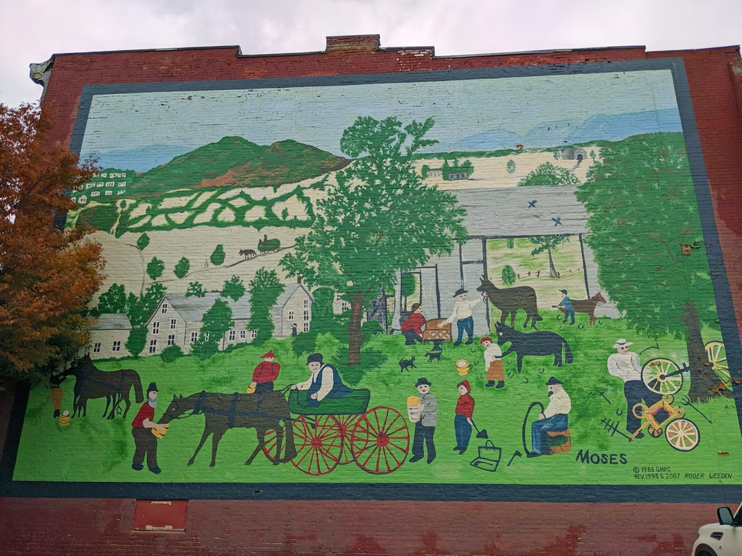 Mural based on Anna Mary Robertson's, a.k.a. Grandma Moses, 1960 painting Wagon Repair Shop; photo by Robin Catalano.