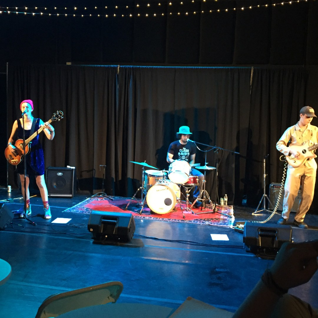 Photo of the rock band, Yolk Bath, performing on stage.