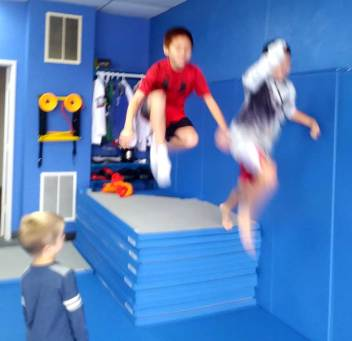 potluck-oct-2018-kids-jumping-2