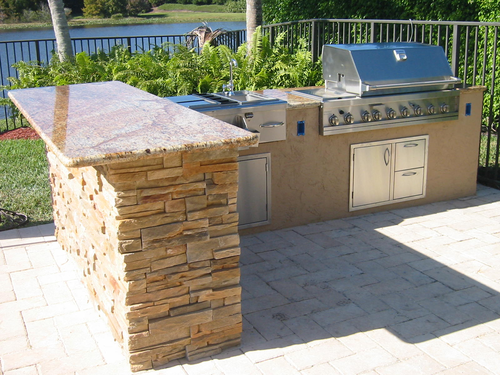 l shaped outdoor kitchen natural walnut cabinets custom in florida with granite  gas
