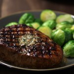Smoky Spice Rubbed Pork CHops with Garlic Herb Butter