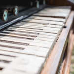 Old Piano out at Luck Reunion shot by Maggie boyd