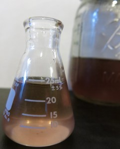 The color of the lilac simple syrup is a dusky purple.