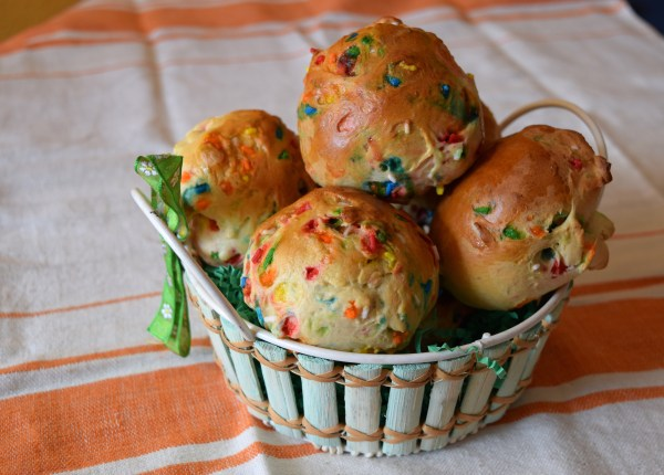 Happy bright sprinkle filled funfetti hot cross buns in an easter basket!