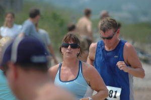 Theresa approaching the FINISH LINE of her first triathlon, Block Island 2007