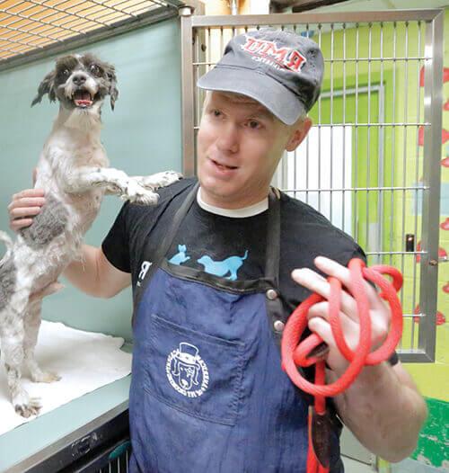 Imhof holding happy rescue dog