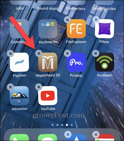 Нажмите X на значке приложения iPhone