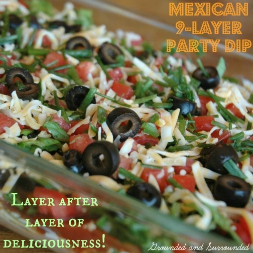 Need an easy, healthy and fun dish to take to your next potluck or party? This 9- Layer Mexican Party Dip does not disappoint with it's fresh and bold flavors. Who doesn't love layers of fresh ingredients piled high? This dip will be the hit of your next get together. Guaranteed. | groundedandsurrounded.com