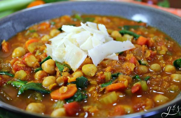 "This quick vegetarian dinner recipe is full of bold and unique flavors- perfect for a ""Meatless Monday""! Make this vegetarian by using vegetable stock with the lentils and chickpeas. Go a step further and make it vegan by omitting the butter. Despite the lengthy list of ingredients, this healthy soup really comes together quickly! We love that this gluten free whole food recipe is packed full of protein, and leaves you feeling full and satisfied!"