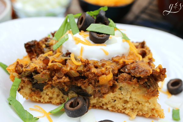 The BEST Clean Eating Mexican Cornbread Casserole | This healthy, easy, and gluten-free recipe contains no processed ingredients and TONS of veggies aka WHOLE FOODS like onion, spinach, bell pepper, and salsa! It can be made with ground beef or any other meat such as buffalo, venison, or ground turkey. If you are looking for a new from scratch homemade family meal this one's for you!