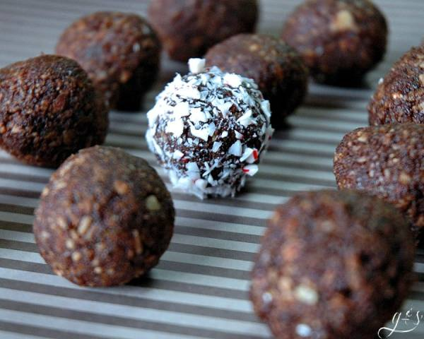 These - healthy - no bake - raw - 5 Ingredient Peppermint Cocoa Energy Bites are the BEST and every bit as delicious as they sound. Chocolate + Peppermint = BLISS! Gluten free and sugar free, these little holiday protein treats use the most simple of ingredients: nuts, dates, cocoa powder, & peppermint extract. Roll in crushed candy canes or shredded coconut for an added dose of yumminess!