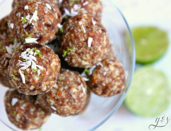4 Ingredient Coconut Lime Energy Bites | This easy no bake recipe will quickly become your favorite healthy snack especially during the hot summer months! Gluten-free dates, almonds, coconut, and lime combine to create a clean eating, Paleo, 21 Day Fix & Whole30 approved, and vegan recipe that is perfect for kids and adults alike. Take on your next camping trip, hike, or pack for your kids school lunch!