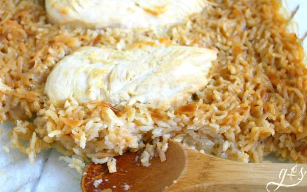 The BEST Chicken & Rice Casserole | This creamy and easy homemade recipe only requires 5 simple ingredients! A little rice, a can of Cream of Chicken soup, onion soup mix, and chicken have never tasted so good in this baked dish. Let your kids help you prepare this quick comfort foods recipe! Add a side salad or cooked veggie and Viola you have a family favorite meal in the making. {Families - Dinners - Recipes}