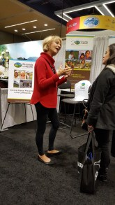 Board member Linda Smithers of Daterra Coffee working the booth.