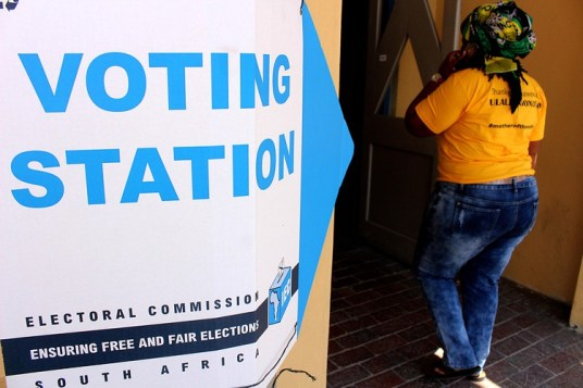 Photo of a person entering a voting station