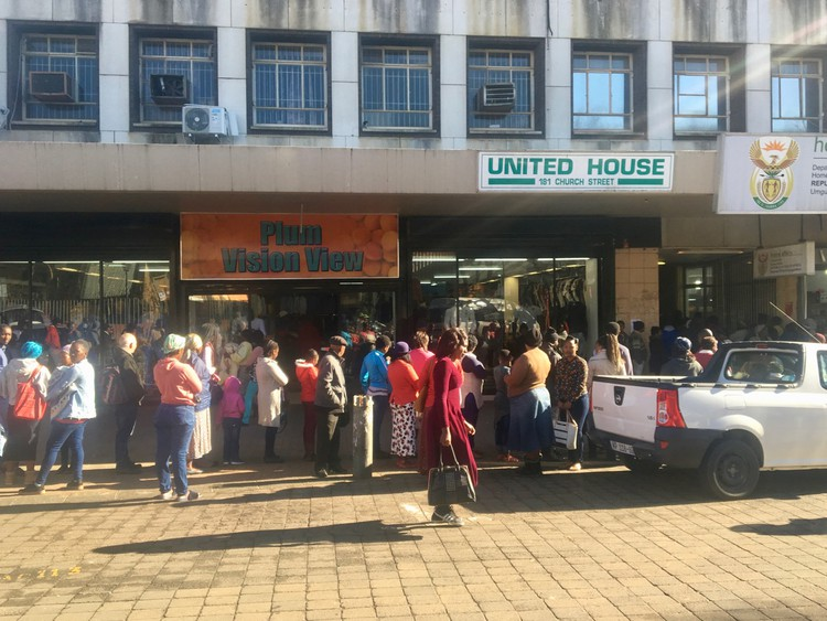 Photo of queues outside a building