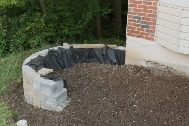 Versa-lok cobble stone DIY retaining wall After