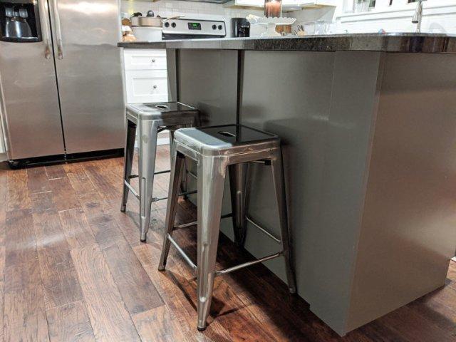 Metal stools at kitchen island