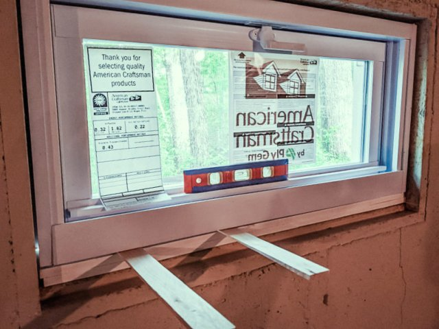 Leveling new window with wooden shims