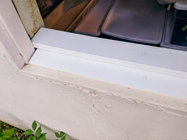 PVC trim board to prop up window and fill gaps
