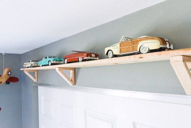 Vintage model cars on shelf in toddler room