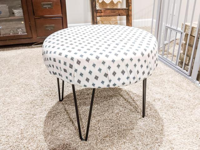 Nursery glider ottoman from C's nursery with tribal print