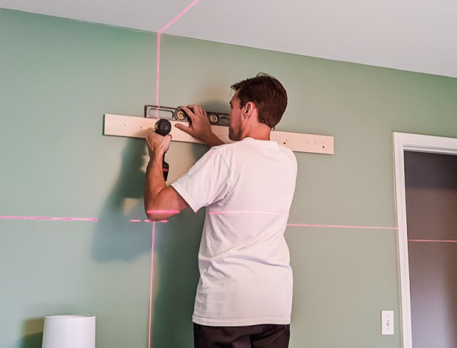 Hanging 1x4 brace onto the wall