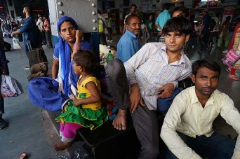 An Indian family waiting for a train