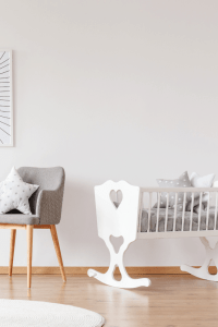 white baby bassinet in a nursery
