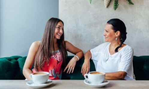 two women chatting while having coffee