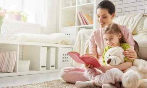 mom and daughter of a big family reading together